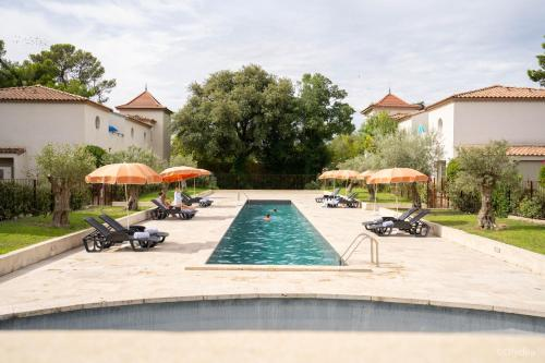 The swimming pool at or near Adonis La Redorte By Olydea