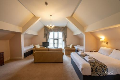 A bed or beds in a room at Broome Park Hotel