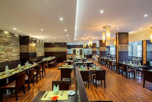 A restaurant or other place to eat at Millennium Central Al Mafraq