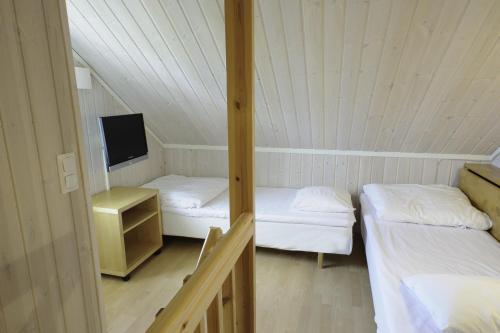 Säng eller sängar i ett rum på Apelvikens Camping & Cottages