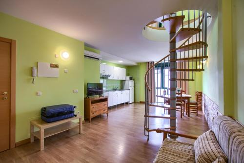 A kitchen or kitchenette at Apartamentos Barajas