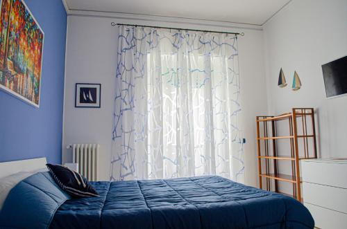 A bed or beds in a room at Primopiano Holiday House