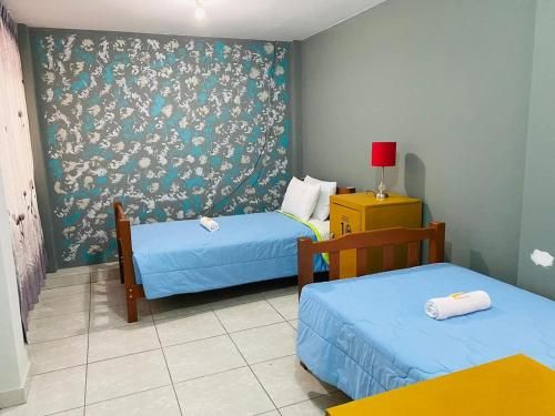 A bed or beds in a room at Sunset Hostel Airport