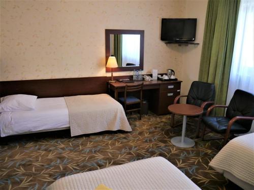 Łóżko lub łóżka w pokoju w obiekcie Centrum Barnabitów