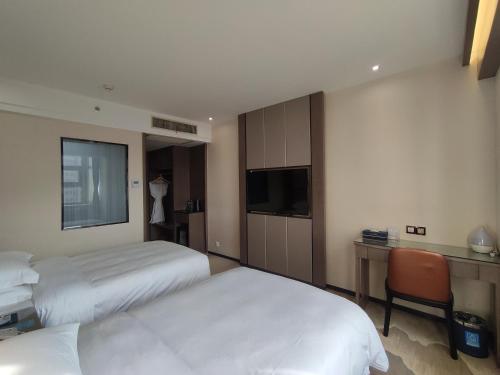 Кровать или кровати в номере Lanzhou Hualian Hotel