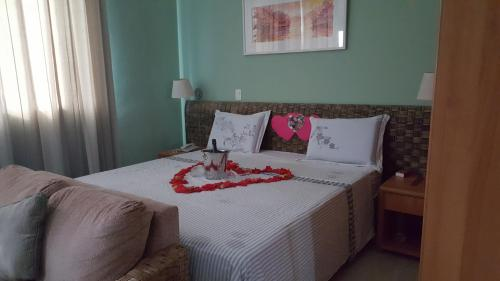 A bed or beds in a room at FLAT TROPICAL PARTICULAR
