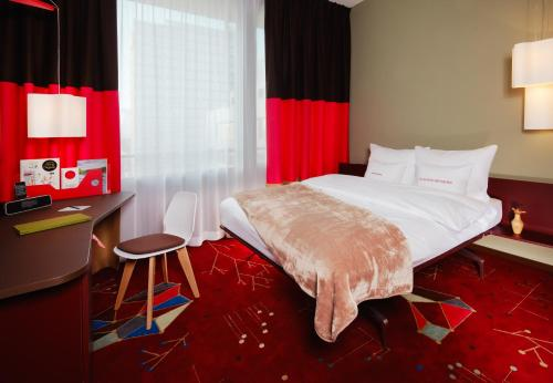 A bed or beds in a room at 25hours Hotel Zürich West