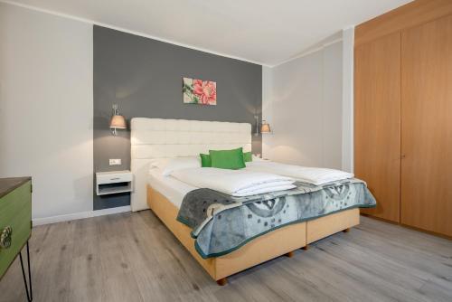 Een bed of bedden in een kamer bij Hotel Aster