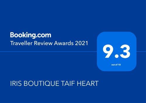 Um certificado, prêmio, placa ou outro documento exibido em IRIS BOUTIQUE TAIF HEART
