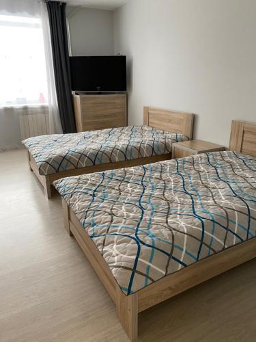 Кровать или кровати в номере Apartment na Lenina 13