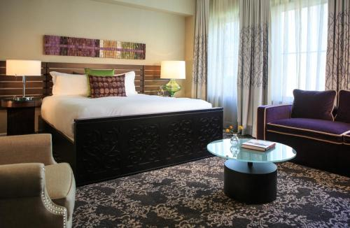 A bed or beds in a room at Kimpton Hotel Vintage Seattle, an IHG Hotel