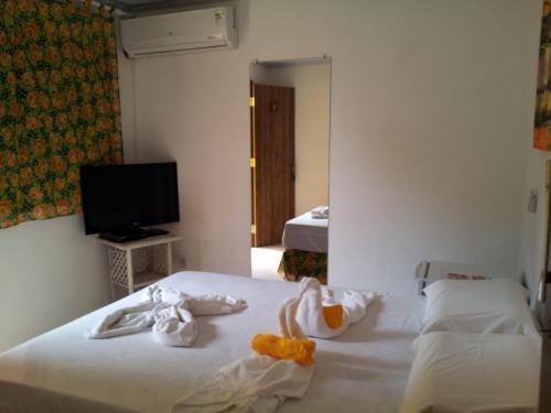 A bed or beds in a room at Pousada Caminho das Estrelas