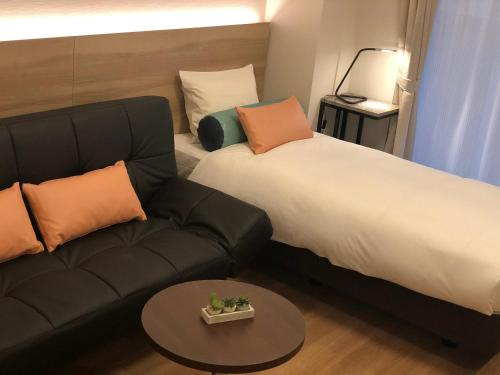 A bed or beds in a room at Doutonbori Crystal Hotel Ⅱ