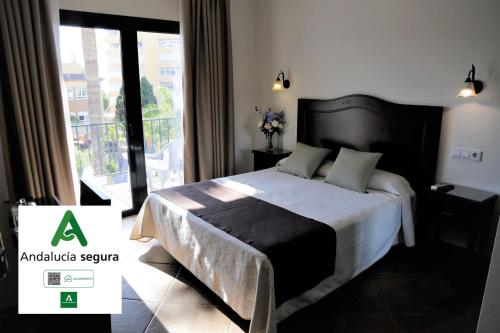 A bed or beds in a room at Arcos de Montemar