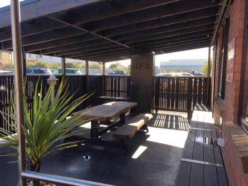 A balcony or terrace at Hokitika Fire Station Boutique Accommodation