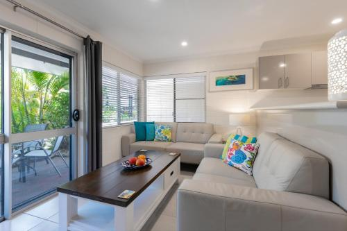 A seating area at Lychee Tree Holiday Apartments