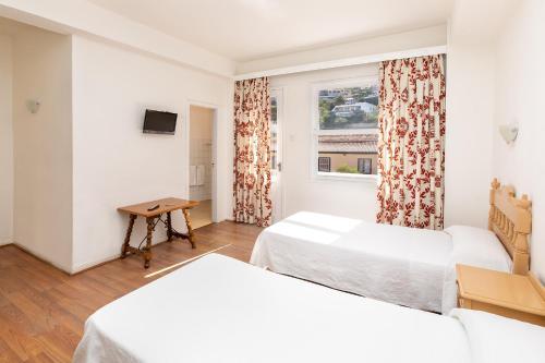 Letto o letti in una camera di Hotel Maga