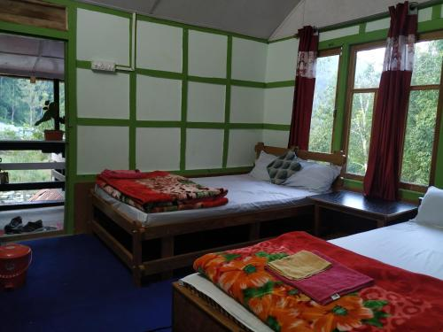 A bed or beds in a room at Bidyang Crown Imperial River Resort