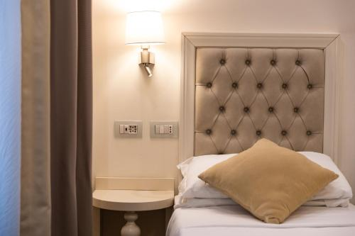 A bed or beds in a room at Relais Monti