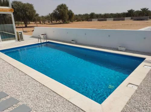 The swimming pool at or near The Farm Chalet