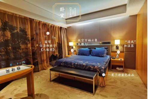 A bed or beds in a room at Ascott Raffles City Beijing