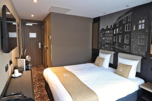Een bed of bedden in een kamer bij XO Hotels Infinity