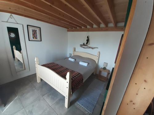 Uma cama ou camas num quarto em Casinha do Barreiro
