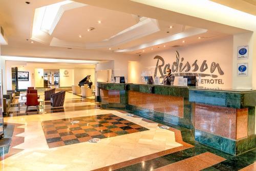 The lobby or reception area at Radisson Bogota Metrotel
