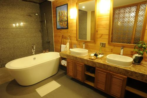 A bathroom at Aroma Beach Resort and Spa