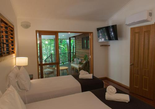 A bed or beds in a room at Thala Beach Nature Reserve