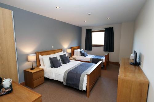 A bed or beds in a room at Afan Lodge