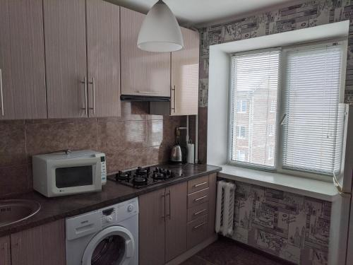A kitchen or kitchenette at Apartment with balcony on Peremohy Avenue 43
