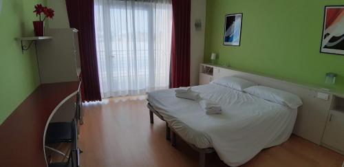 Letto o letti in una camera di Hotel Lago Losetta