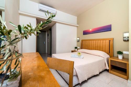 Vuode tai vuoteita majoituspaikassa Afandou Beach Resort Hotel