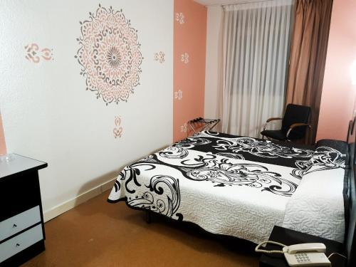 A bed or beds in a room at Hotel Arha Santander
