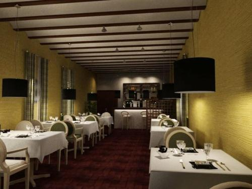 A restaurant or other place to eat at La Almoraima Hotel