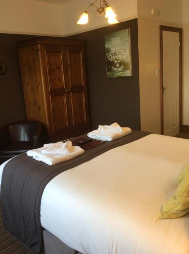 A bed or beds in a room at Promenâd B&B