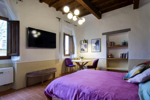 A bed or beds in a room at D'Ardiglione27 Flat Studio Nuovo New
