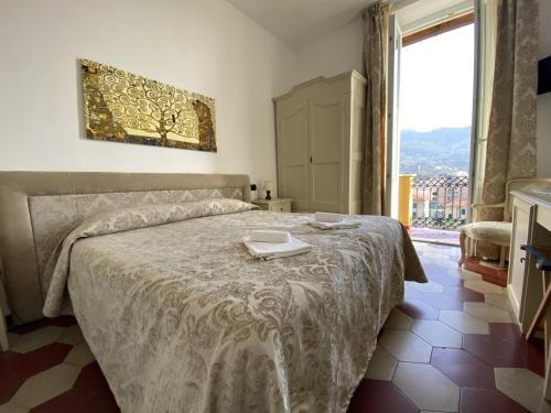 Un ou plusieurs lits dans un hébergement de l'établissement Villa Margherita