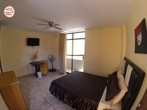 Cama o camas de una habitación en Hostal Huacachina Sunset