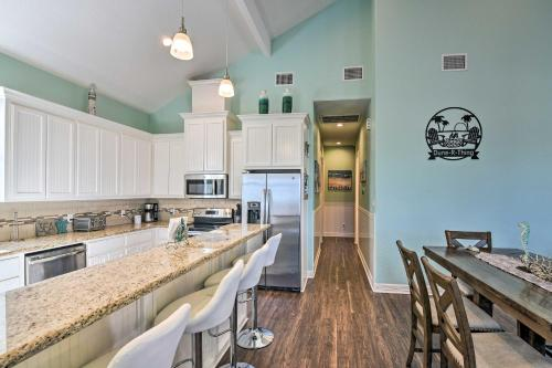 A kitchen or kitchenette at Surfside Getaway with Deck - Walk to the Beach!