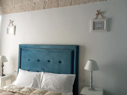 Letto o letti in una camera di B&B La Porta Vecchia
