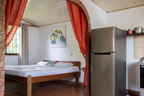 Cama o camas de una habitación en Cabinas Montesol