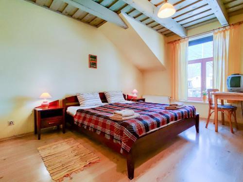 Posteľ alebo postele v izbe v ubytovaní Raibie Logi