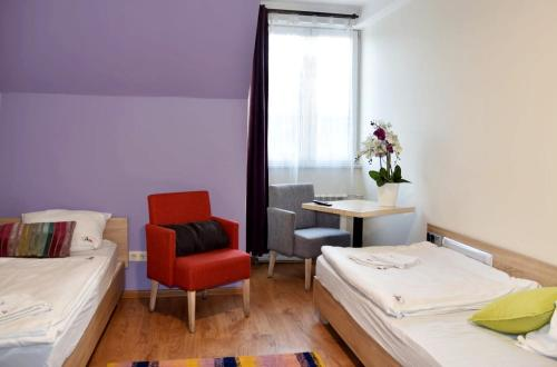 A bed or beds in a room at 3 City Hostel
