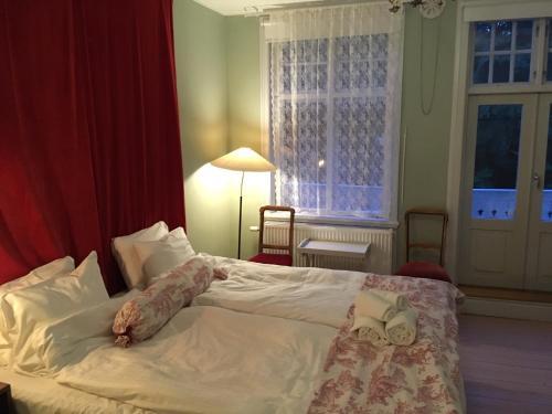 A bed or beds in a room at STF Villa Söderåsen B&B