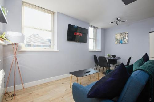 A television and/or entertainment center at The Exquisite Gem of Yorkshire - Duplex - Penthouse - Netflix