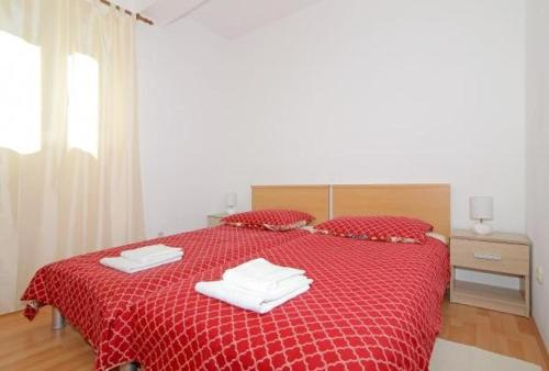 A bed or beds in a room at Apartments M&P