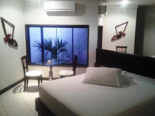 Cama ou camas em um quarto em Toulouse Motel (Adult Only)