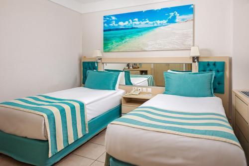 Ліжко або ліжка в номері Fun&Sun Active Club Hydros